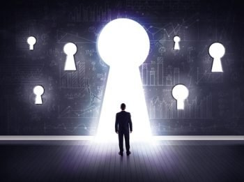 44979025 - successful businessman looking through keyhole